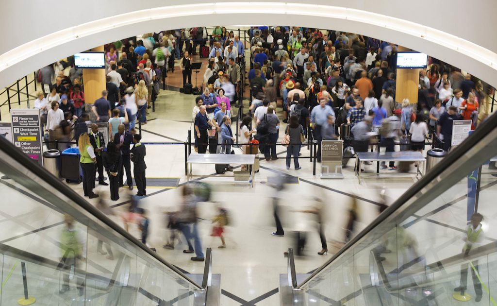 In this Thursday, May 19, 2016, photo, travelers move through a security checkpoint line at Hartsfield-Jackson Atlanta International Airport, in Atlanta. Fliers should brace for long waits at airport security over the Memorial Day weekend. Some major airports were previously seeing wait times exceeding 90 minutes at peak hours, and now the unofficial start of summer is here. (AP Photo/David Goldman)