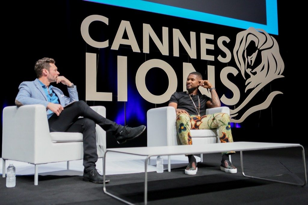 Ryan Seacrest in a fireside chat with Usher on the main stage at Cannes Lions. Tony Barson/Getty Images for iHeartMedia