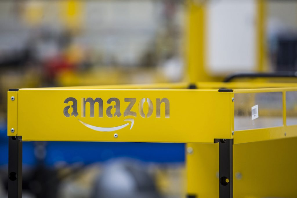 An Amazon logo sits on a collection cart for customer orders on the opening day of the new Amazon.Com Inc. fulfillment center in Dobroviz, Czech Republic, on Tuesday, Sept. 8, 2015. By the year 2018, 2,000 permanent and 3,000 seasonal workers will find a job at the warehouse which already now has 1,500 permanent employees. Photographer: Martin Divisek/Bloomberg