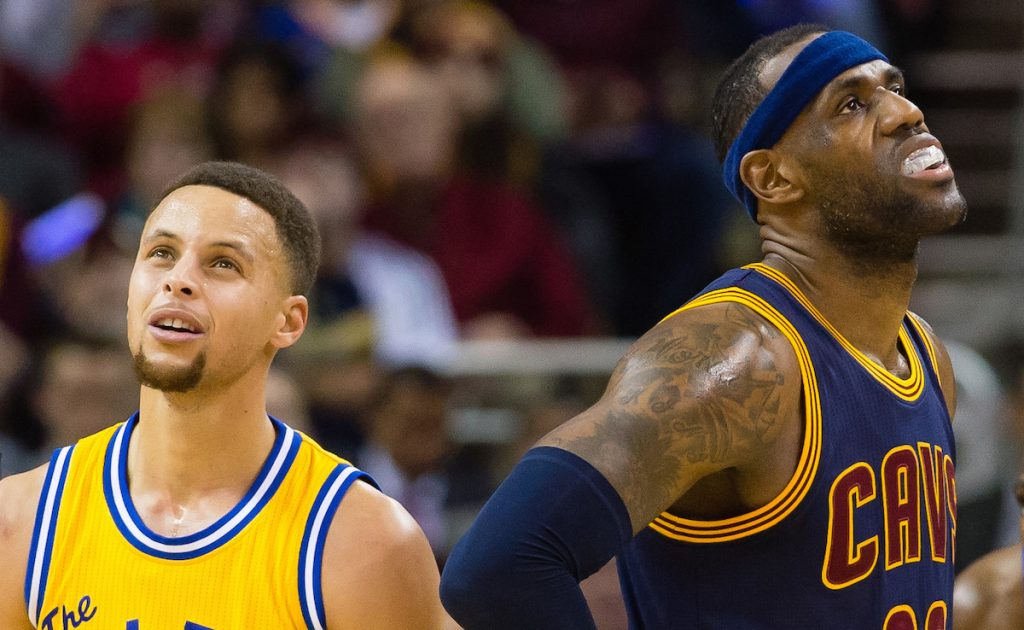 Stephen Curry and LeBron James react during the first half at Quicken Loans Arena on January 18, 2016 in Cleveland, Ohio. (Photo by Jason Miller/Getty Images)