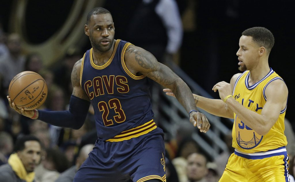 James drives past Curry in the second half of an NBA basketball game, Jan. 18, 2016, in Cleveland. (AP Photo/Tony Dejak)