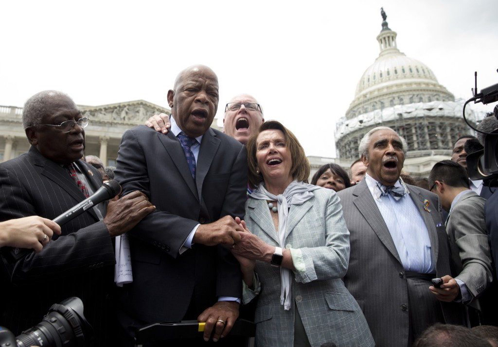 "House Assistant Minority Leader James Clyburn, Rep. John Lewis, Rep. Joseph Crowley, House Minority Leader Nancy Pelosi and Rep. Charles Rangel sing ""We Shall Overcome"". AP Photo/Carolyn Kaster"