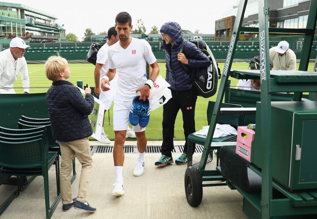 Novak Djokovic leaves the court as the rain starts during previews for Wimbledon Tennis 2016 on June 25, 2016 in London, England. Julian Finney/Getty Images