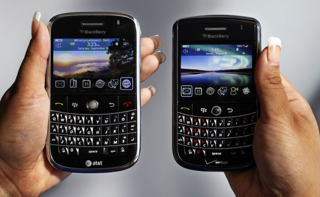"In this Monday, Sept. 21, 2009, file photo, a BlackBerry Bold, left, and Tour, right are photographed in Mountain View, Calif., Monday, Sept. 21, 2009.Troubled smartphone maker BlackBerry has won an early round in its legal battle against an iPhone keyboard made by a startup co-founded by ""American Idol"" host Ryan Seacrest. (AP Photo/Paul Sakuma, File)"