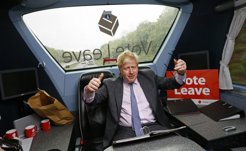 Boris Johnson gestures in the back of the Vote Leave bus as it heads towards Exeter. REUTERS/Darren Staples