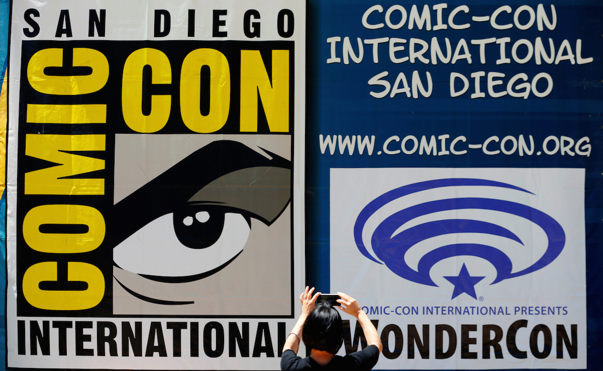 A woman takes a picture of a Comic-Con sign in San Diego, California United States, July 19, 2016. REUTERS/Mike Blake