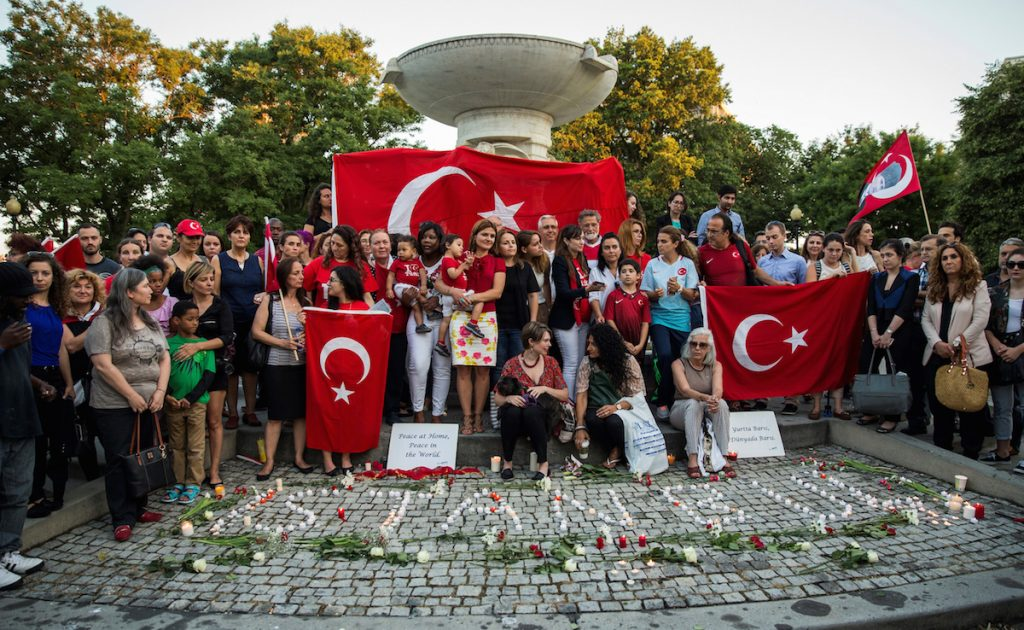 Mourners gather in Dupont Circle to hold a vigil for the victims of the Istanbul Airport terrorist attack Washington, USA on June 29, 2016. (Photo by Samuel Corum/Anadolu Agency/Getty Images)