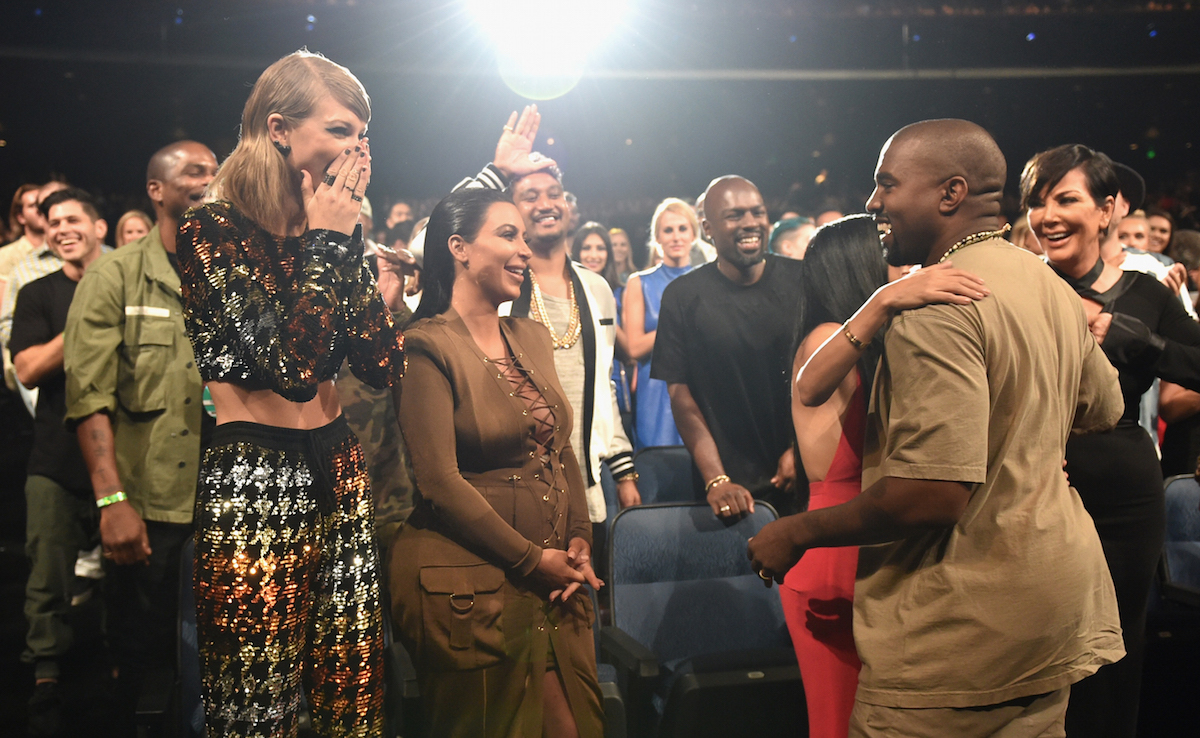 Singer-songwriter Taylor Swift, TV personalities Kim Kardashian, Kourtney Kardashian, rapper Kanye West and TV personality Kris Jenner in the audience during the 2015 MTV Video Music Awards at Microsoft Theater on August 30, 2015 in Los Angeles, California.  John Shearer/Getty Images