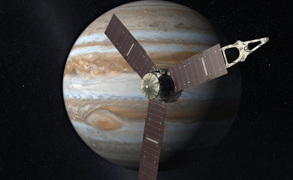 This artist's rendering provided by NASA and JPL-Caltech shows the Juno spacecraft above the planet Jupiter. NASA/JPL-Caltech via AP