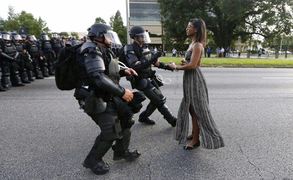 Protester Ieshia Evans is detained by law enforcement near the headquarters of the Baton Rouge Police Department in Baton Rouge, Louisiana. REUTERS/Jonathan Bachman