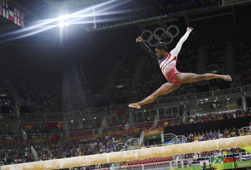 Simone Biles on the beam. REUTERS/Dylan Martinez