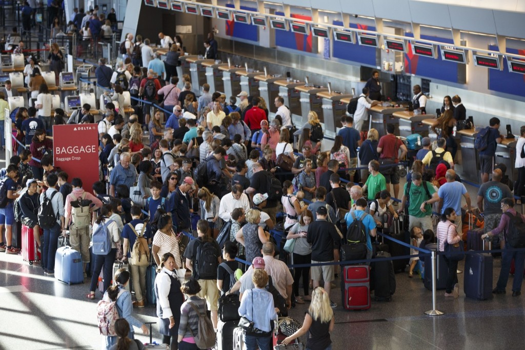 The scene near Delta's check-in counters at Boston Logan International Airport after Delta Airlines grounded its U.S. and international flights. Dina Rudick/The Boston Globe via Getty Images