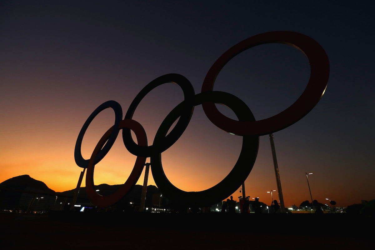 The sun sets over the Olympic Rings on the Olympic Park on August 1, 2016 in Rio de Janeiro, Brazil. Photo by Clive Rose/Getty Images