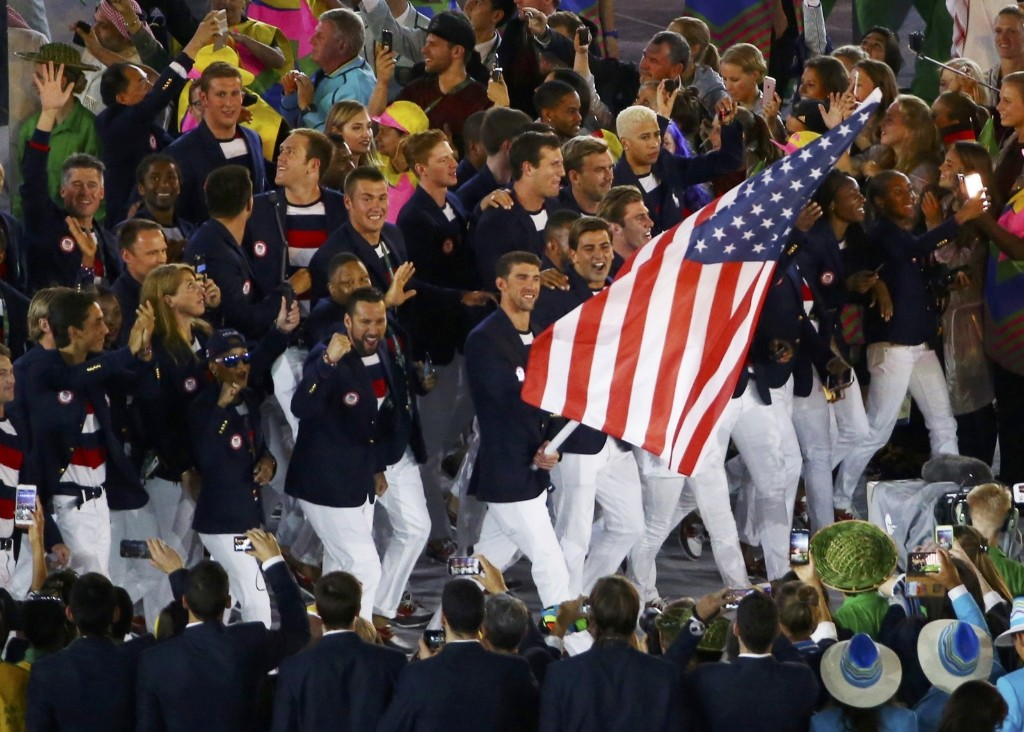 Flag-bearer Michael Phelps leads the USA contingent. REUTERS/David Gray