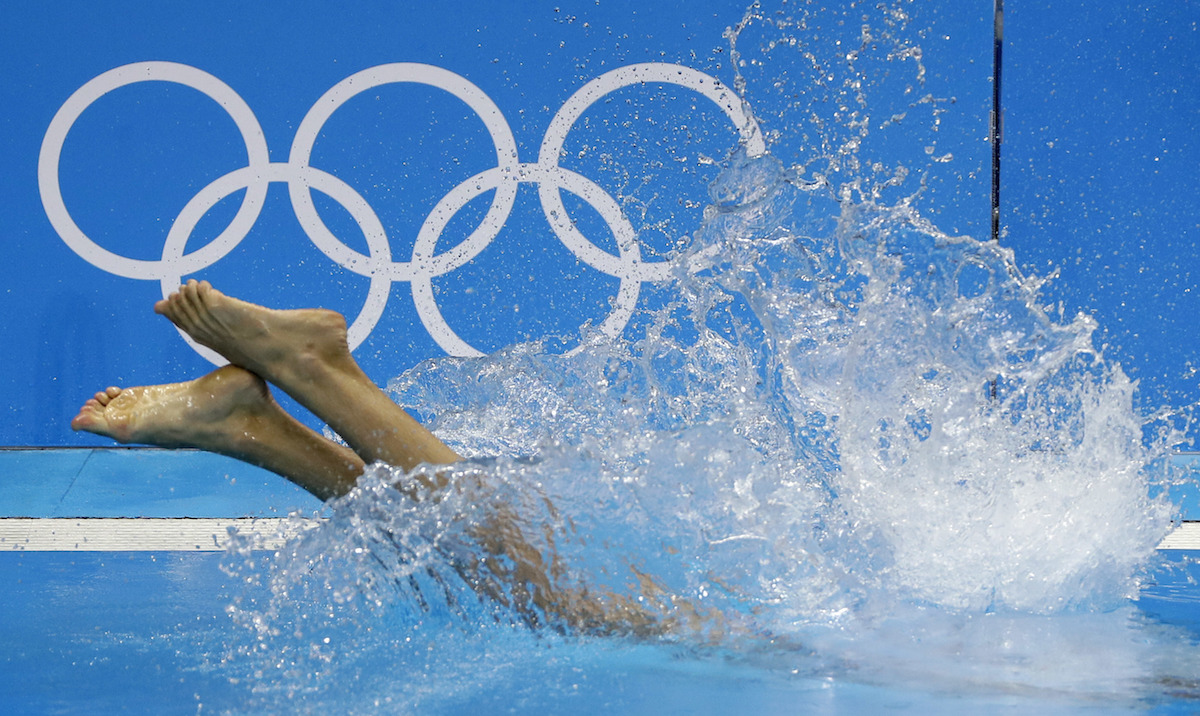 An athlete jumps into the Olympic pool of the aquatics center ahead of the 2016 Summer Olympics in Rio de Janeiro, Brazil, Tuesday, Aug. 2, 2016. AP Photo/Matt Slocum
