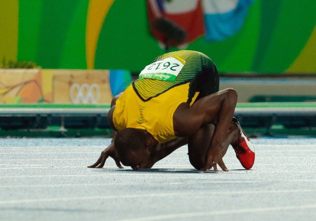 Gold medalist Usain Bolt of Jamaica kisses the track after winning the men's 200m final. Gary Hershorn/Flipboard