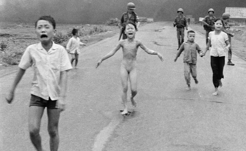 FILE - This is a June 8, 1972 file photo of South Vietnamese forces follow after terrified children, including 9-year-old Kim Phuc, center, as they run down Route 1 near Trang Bang after an aerial napalm attack on suspected Viet Cong hiding places . Norway's Prime Minister Erna Solberg on Friday Sept. 9, 2016 challenged Facebook's restrictions on nude photos by posting an iconic 1972 image of a naked girl running from an aerial napalm attack in Vietnam. The Pulitzer Prize-winning image by Associated Press photographer Nick Ut is at the center of a heated debate about freedom of speech in Norway after Facebook deleted it from a Norwegian author's page last month. (AP Photo/Nick Ut, File)
