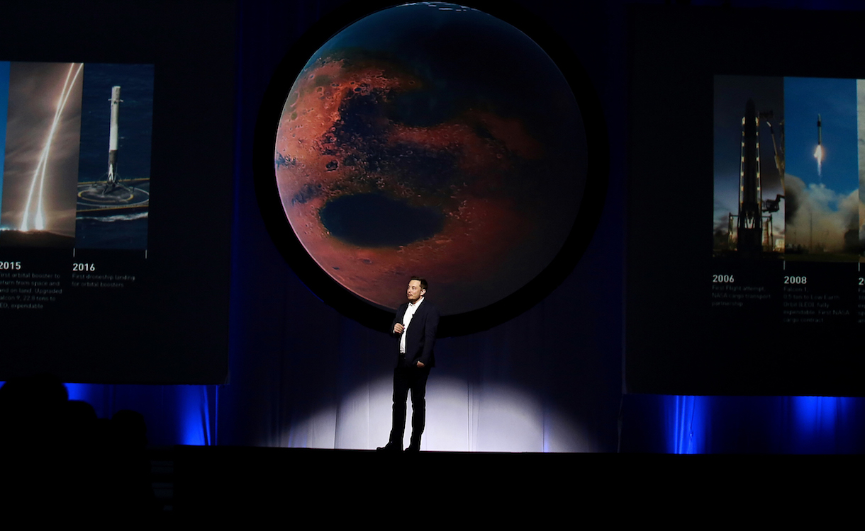 Elon Musk, chief executive officer for Space Exploration Technologies Corp. (SpaceX), speaks during the 67th International Astronautical Congress (IAC) in Guadalajara, Mexico, on Tuesday, Sept. 27, 2016. Musk's vision for building a self-sustaining city on Mars will require full rocket reusability, refueling the spacecraft in orbit and propellant production on the Red Planet. Photographer: Susana Gonzalez/Bloomberg via Getty Images
