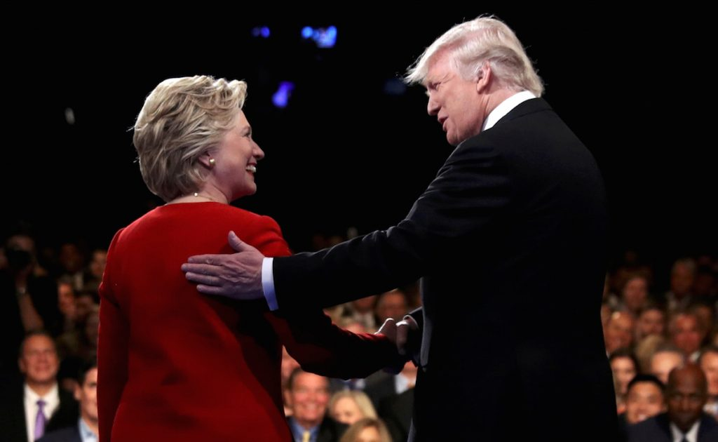 Trump shakes hands with Clinton at the start of their first presidential debate at Hofstra University in Hempstead, New York, U.S., September 26, 2016. REUTERS/Joe Raedle/Pool      TPX IMAGES OF THE DAY