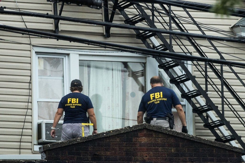 The FBI and other law enforcement officials investigate a residence in connection with the bombings in Elizabeth, N.J. Drew Angerer/Getty Images