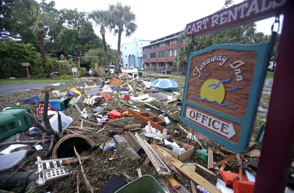 A street is blocked from debris that washed up from the tidal surge of Hurricane Hermine in Cedar Key, Fla. AP Photo/John Raoux