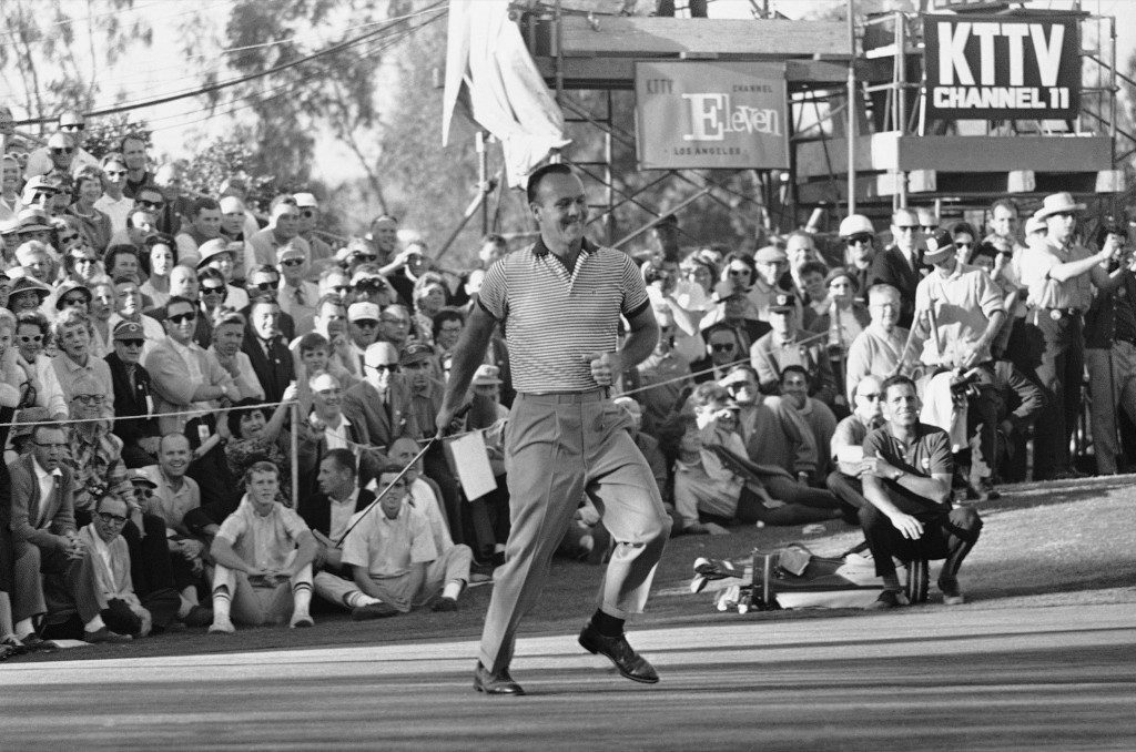 Arnold Palmer strides across the 18th green with nothing left to do but tap the ball into the cup for first place in the Los Angeles Open golf tourney, Jan. 8, 1963. AP Photo