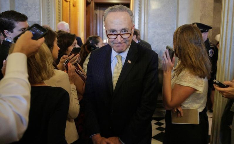 Senator Chuck Schumer (D-NY) walks after the Senate voted to override U.S. President Barack Obama's veto of a bill that would allow lawsuits against Saudi Arabia's government over the Sept. 11 attacks, on Capitol Hill in Washington, U.S., September 28, 2016. REUTERS/Joshua Roberts