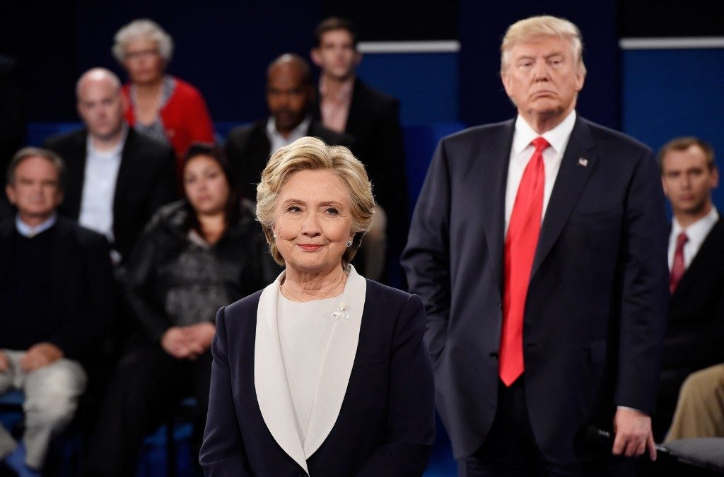 Hillary Clinton and Donald Trump listen during the town hall debate. Saul Loeb/Pool/Getty Images