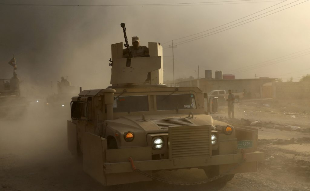 An Iraqi military humvee advances towards the city of Mosul, Iraq, Wednesday, Oct. 19, 2016.  AP Photo