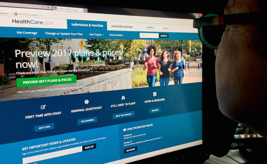 A woman looking at the Healthcare.gov internet site in Washington, DC. KAREN BLEIER/AFP/Getty Images