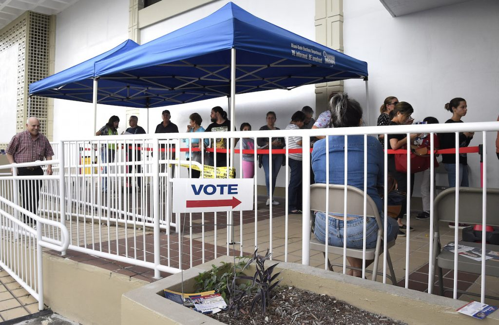 People line up to vote at an early voting polling centre in Miami, Florida on November 3, 2016. RHONA WISE/AFP/Getty Images