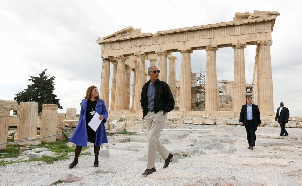 President Barack Obama passes the Parthenon while touring the Acropolis with Dr. Eleni Banou from the Ministry of Culture in Athens, Greece. REUTERS/Kevin Lamarque