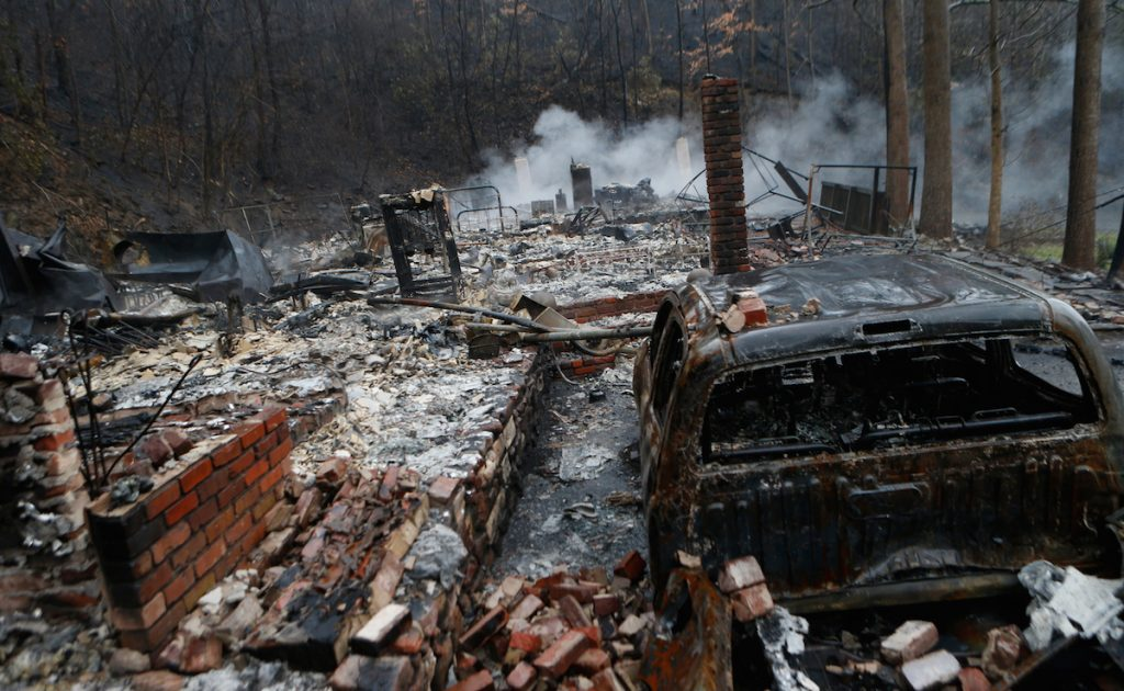 The remains of a home smolder in the wake of a wildfire November 30, 2016 in Gatlinburg, Tennessee. Brian Blanco/Getty Images