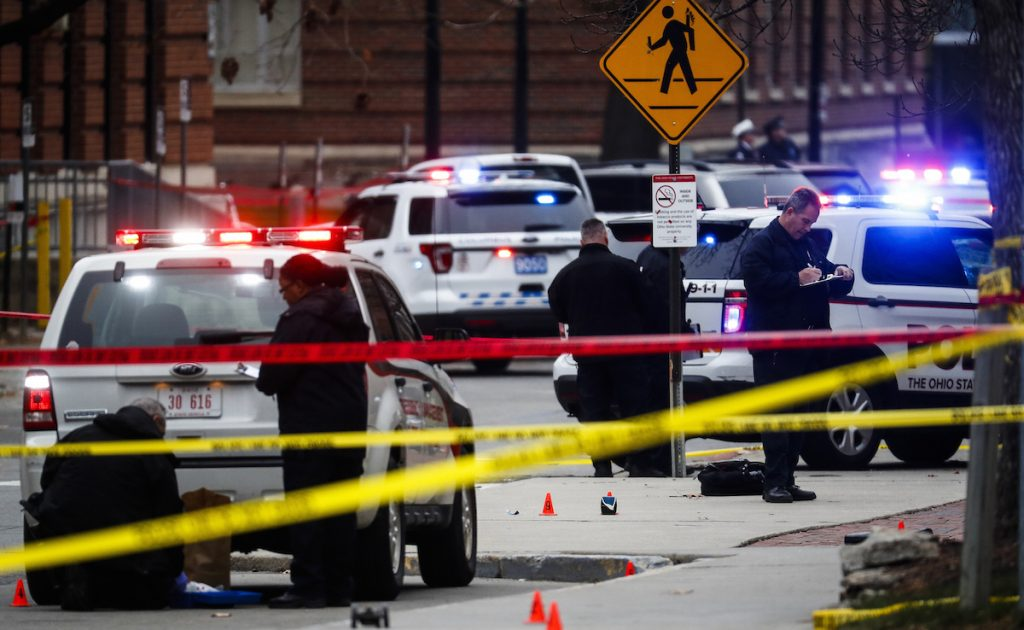 Crime scene investigators collect evidence from the pavement as police respond to an attack on campus at Ohio State University, in Columbus, Ohio. AP Photo/John Minchillo, File